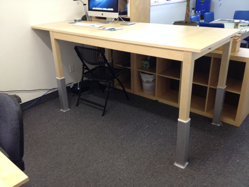Raise your office desk for better health and a better back.